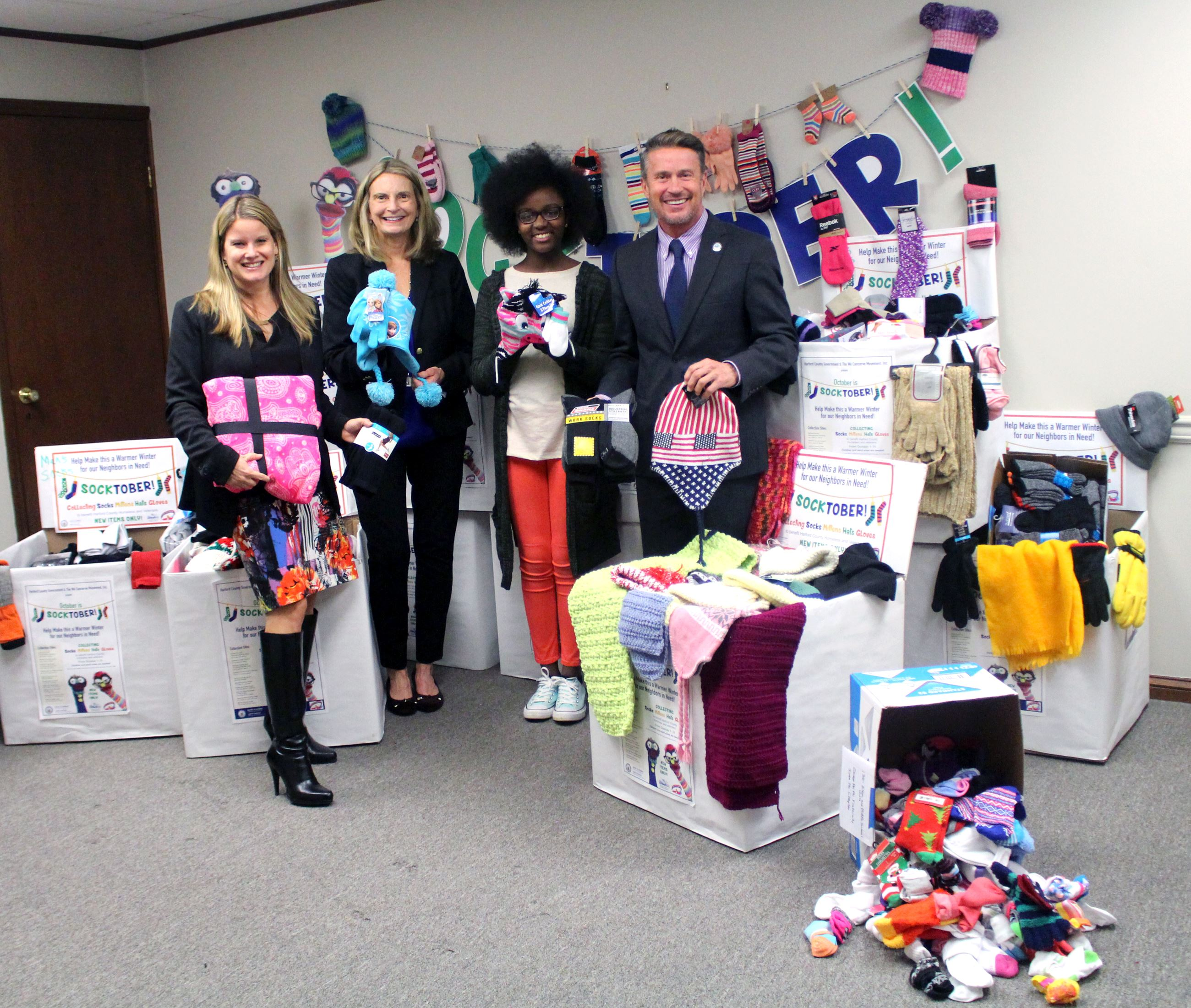 Socktober Donations with Barry Glassman Mary Hastler Amber Shrodes and Grace Callwood